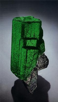 Emerald.  Size: 11.5 by 6 cm, 2800 carats.  Locality: Tokovaya, Russia.  Collection: American Museum of Natural History.  Photo: Harold & Erica Van Pelt.