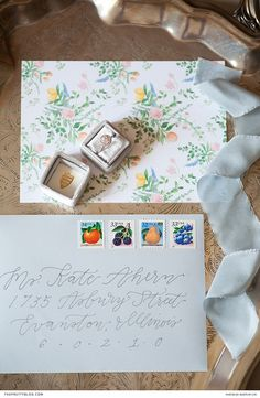 Muted blue envelopes were decorated with stamps displaying citrus fruits, as a nod to the summer season that inspired a timeless rehearsal dinner. Wedding Stationery Inspiration, Spring Wedding Inspiration, Wedding Ideas, Wedding Bands For Him, Wedding Rings, Blue Envelopes, Box Supplier, Citrus Fruits, Emily Rose
