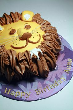 Lion birthday cake : use a cupcake top for the nose rise and split the bottom of the cupcake in half for the ears.