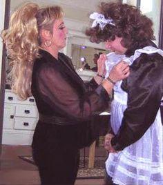 Pvc sissy maid in shocking pink pvc sissy maid training for Escort girl salon