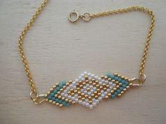 L'association d'un joli tissage de perles miyuki fait main aux couleurs élégantes et d'une chainette plaqué or compose ce joli bracelet. Le bracelet mesure 19 cm et le tissage 5 - 18580363