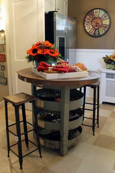 From Hammers and High Heels. This is a great idea for limited space! Lazy Susan storage under the table!