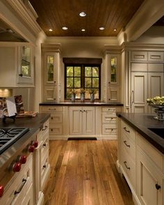 wood ceiling, cream antique finish cabinets