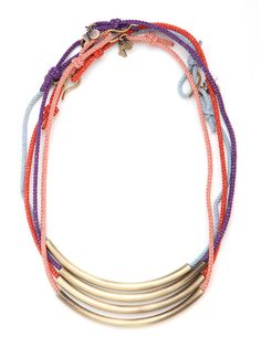 Love a good tribal trend? Love kaleidoscopic color even more? Why not have both in these colorful necklaces, complete with a crafty African vibe and glam gold hardware