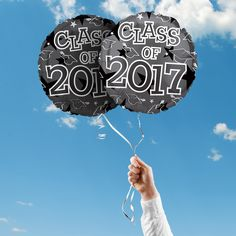 """Includes 2 Black and White 17"""" round Class of 2017 graduation foil balloons. """"Class of 2017"""" is printed on both sides of the balloons. Use balloons for your graduation party centerpieces or balloon bouquets."""
