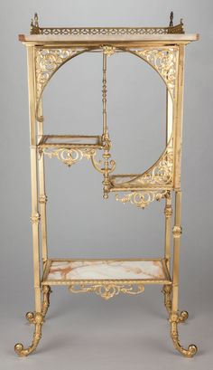 A FRENCH-STYLE GILT METAL ÉTAGÈRE WITH ONYX SHELVES . Late 19th century.