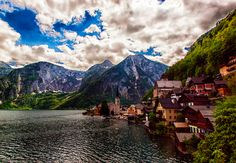 "Hallstatt, Austria  Hallstatt, considered to be the oldest still-inhabited village in Europe, is home to just under 1,000 people, and has evidence of inhabitants since prehistoric times. Sometimes called the ""pearl of Austria,"" Hallstatt is considered to be one of the most beautiful places on Earth."