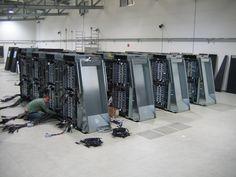 Engineer finishing the cabling on the IBM Blue Gene/P super computer. 72 racks, 144TB of memory & 825.5 Teraflops of computing power.