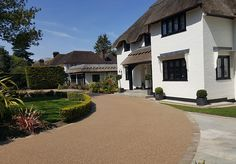 Resin Bound Gravel Driveway in Flaxen Pea colour, Orpington, Kent installed by Clearstone Block Paving Driveway, Permeable Driveway, Resin Driveway, Driveway Design, Driveway Landscaping, Driveway Ideas, Resin Bound Gravel, Resin Bound Driveways, Outdoor Pergola