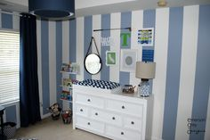 Love this sweet baby boy gallery wall over the changing table!