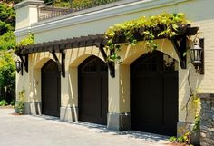 pergola over garage - Google Search This pergola would be stunning over our garage! Carolina jessamine or Clematis armandii are two good flowering vines that are evergreen here.