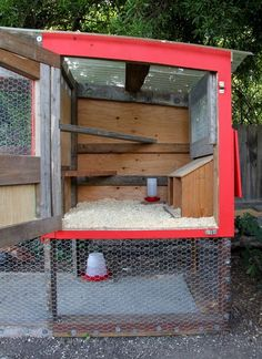 Simple chicken coop .. oh i love it.. it looks easy to clean, easy access via 3 doors, lots of ventaliation, can use the left over materials from the house to make.. not sure if i want red door for it!:
