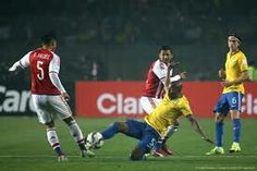 Brazil 1 Paraguay 1 (3-4 p) in 2015 in Concepcion. Bruno Valdez and Fernandinho go in for the tackle in the Quarter Final at Copa America.