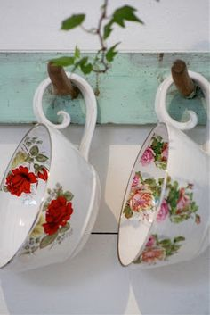 Bringing outdoors in...little sprig of ivy decorating a teacup rack (Country cottage style)