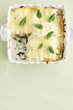 Zucchini-and-Spinach Lasagna - Fresh Zucchini Recipes - Southernliving. Recipe: Zucchini-and-Spinach Lasagna  Pack your farmers' market favorites in this vegetarian lasagna. Fresh basil, zucchini, and spinach are baked with both ricotta and flavored cream cheese for a hearty casserole. No-boil lasagna noodles will help you get this dish on the table in no time