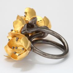 Buttercup Flower Ring - would be nice with fewer flowers or single flowers as earings, too.