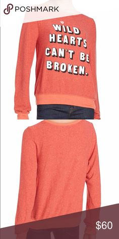 "WILDFOX ""wild hearts can't be broken"" shirt SZ XS Comfy solid scoopneck design flaunts contrast trims Scoopneck Long sleeves Pullover style About 25"" from shoulder to hem Polyester/rayon/spandex Machine wash Made in USA Wildfox Tops"