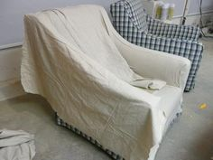 I used this technique to recover my couch last year. Instead of drop cloths I used table cloths from Target!  Super easy!