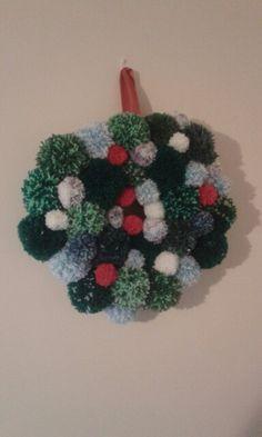 A Christmas wreath made of pom poms