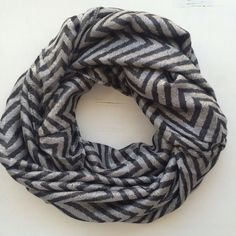 Shimmery Chevron Infinity Scarf Super cute! Good condition! Black and silverfish gray chevron pattern. Cato Accessories Scarves & Wraps