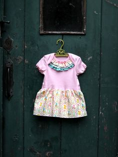 Get inspired to create an Embellished Onesie Baby Girl Dress from Lindsay Wilkes, The Cottage Mama. A quick, easy baby gift!
