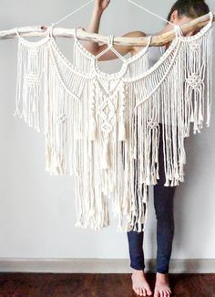 A beautiful branch. A fusion of knots. Lots of fringe. It's all part of this macrame wall hanging.