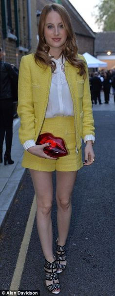 Rosie Fortescue commands attention in a buttercup yellow shorts suit #dailymail