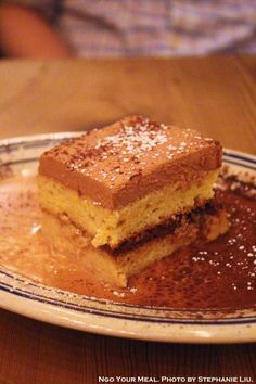 Tres Leches: Vanilla Sponge Cake, Pecans, Chocolate Cream, Firelit Coffee Liqueur at Rosie's in New York City