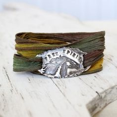 "The perfect silk wrap bracelet for any horse lover. This gorgeous bracelet features a horse silhouette with ""free spirit"" stamped above it. Hand sculpted from reclaimed fine silver this unique silk bracelet wraps around your wrist about 4 times for a fun eclectic look.    {Shown on Sunflower silk}"