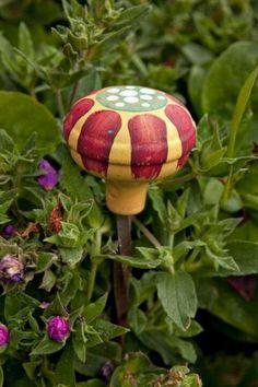 Upcycled doorknob as garden stake or hose guide.  Great idea!  Refurbished doorknob.  garden ideas.  gardening.  recycle design.  repurposed doorknob.