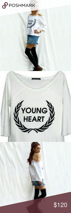 """Wildfox Short Sleeve Sweater Love Potion No. 9 Wildfox Young Heart Flashdance Off-the-Shoulder Sweatshirt in White  The Wildfox Young Heart Flashdance Off-the-Shoulder Sweatshirt in White is a vintage-inspired gem. Made from a soft cotton fleece, the off-the-shoulder top features rolled-up sleeves. Its """"Young Heart"""" screen-print design gives the easy-to-wear sweatshirt its finishing touch. Item is true to designer letter sizing, slightly relaxed throughout. Size small. Like new condition…"""
