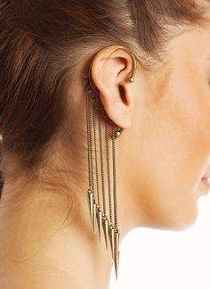 This statement ear cuff is a stunning piece with chain fringe finished and dangling spike charms. Inspire your style with this edgy and rock-n-roll trends for a fun and flirty look. No piercing required. This unique piece hangs comfortably over your ear to create a fun, stylish look.