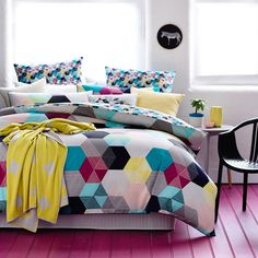 A fashion forward, modern design that features bold hexagons in an array of vivid colours, the Hexx quilt cover set will create an edgy, contemporary look in any bedroom. Printed onto a luxuriously soft cotton percale and fully reversible, this exclusive design allows for alternate styling options. Complete the look with coordinating European pillowcases and a matching cushion, also available in the Hexx range.