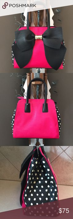 """New🎀 Betsey Oh Bow Satchel Fuchsia front & back with polka dot sides & black bottom. Large black bow with gold center. Bag has fully adjustable, detachable shoulder strap & 6"""" handle drop. Sides expand by unsnapping center strap with center snap closure. Inside 1 zip pocket & 3 slip pockets. NWT Betsey Johnson Bags"""