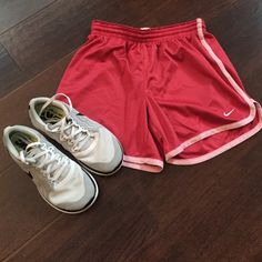 Nike running shorts New Nike adult small youth XL. Cute red with pink trim Nike Shorts