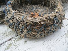 It is lavender harvest time in Northern New York!    These little baskets are made entirely from the harvested lavender stalks that come out of my garden.    Using the entire lavender stalk, stem and flowers both, small bundles are gathered and coiled into the basket shape. The center base features a walnut slice. Waxed linen thread was used as the binding material.The thread is either blue or light lavender color. These little baskets have not been treated with any finish so that the…
