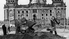 Trümmerfrauen: women clear rubble and recycle bricks outside the Reichstag, in Berlin, after the end of the second World War. Photograph: Ullstein/Getty