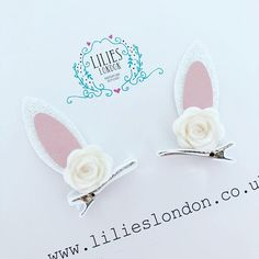 ABOUT ............ Gorgeous, handmade, chunky white, glitter and leatherette bunny ears, with wool felt roses. The ears have been attached to a 35mm barrette style clip. These beautiful clips are perfect for pigtails. The hair clips are made using high quality, non shed glitter