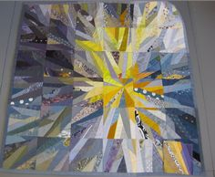 A quilt by Ursula Kern. It is an excellent example of luminosity. Because yellow has been combined with dark dull colors (black +) the yellow appears to glow. If only pale grey had been used, this affect would not exist.