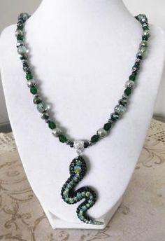"""Emerald Serpent"" necklace & earrings set  $28"