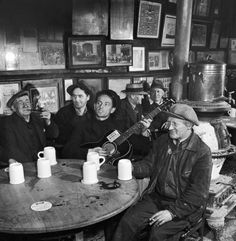 If you play more than two chords, you're showing off. ~ Woody Guthrie ~ photo @ Eric Schaal, thank you. Woody Guthrie playing at McSorley's Old Ale House in New York City. The bar is at 15 East St. It opened in 1854 and still operates today. Billie Holiday, New York Photos, Old Photos, Vintage Photos, Vintage Photographs, The Clash, Woody, Old Ale, Folk Music
