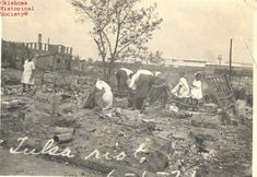Women and children digging through the rubble after the Tulsa Race Riot (Courtesy of the Oklahoma Historical Society Research Division.) (Why you should teach about this little taught race riot in 1921)