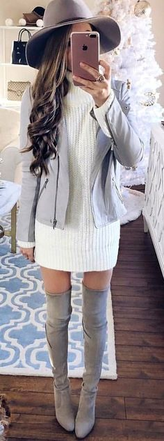woman wearing white sweater dress with gray cardigan, sunhat, and pair of thigh high boots outfit. Pic by @fashiondemands