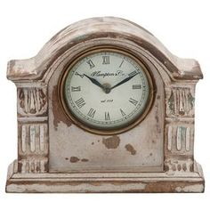 """A perfect complement to antiqued decor or rustic vignettes, this vintage-inspired mango wood table clock features a distressed finish and arched silhouette.  Product: Table clockConstruction Material: Brass and mango woodColor: BrassFeatures:  Vintage-inspired designArched silhouetteAccommodates: Batteries - not includedDimensions: 2.5"""" H x 8"""" W x 9"""" D"""