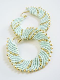 How to make macrame earrings with a pretty swirl pattern and a sprinkling of seed beads.