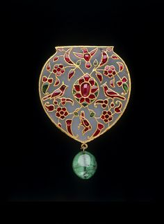 Pendant, white nephrite jade, set with rubies and emeralds in gold using kundan technique. India, possibly Pakistan, circa early 17th century