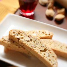 Rose-and cardamom-poached baby figs with chocolate biscotti and almond cream