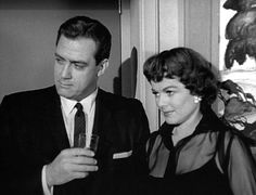Perry Mason (Raymond Burr) and Della Street (Barbara Hale) at a party enjoying a cocktail and some subdued, slightly gossipy conversation.