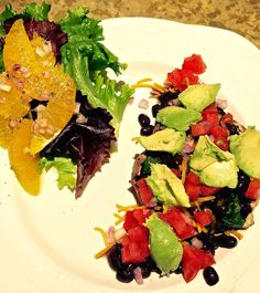 Portobella mushroom with spinach, beans shallots, cheese, tomatoes, and avocados.  Plus an orange salad.