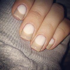 Khloe Kardashian's half-moon mani in nudes.
